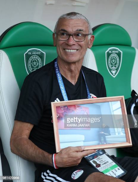 Egypt's coach Hector Raul Cuper poses with a picture during a training session at the Akhmat Arena stadium in Grozny on June 22 2018 during the...
