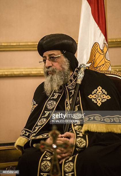 Egypt's Coptic Pope Tawadros II receives condolences at SaintMark's Coptic Cathedral in Cairo's alAbbassiya district on February 16 a day after the...