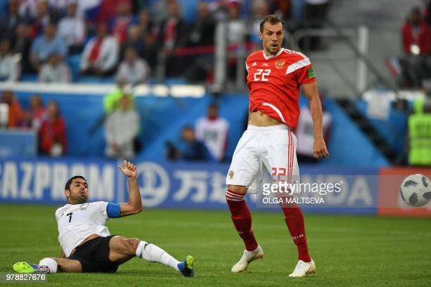 TOPSHOT Egypt's defender Ahmed Fathi scores an own goal in front of Russia's forward Artem Dzyuba during the Russia 2018 World Cup Group A football...