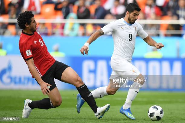 Egypt's defender Ahmed Hegazi challenges Uruguay's forward Luis Suarez during the Russia 2018 World Cup Group A football match between Egypt and...