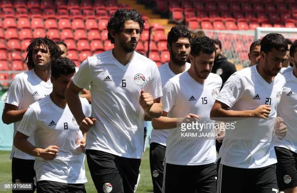 Egypt's defender Ahmed Hegazi Egypt's defender Mahmoud 'El Winsh' Hamdy and Egypt's forward Mahmoud 'Trezeguet' Hassan jog during a training session...