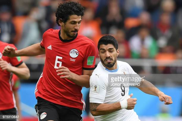 Egypt's defender Ahmed Hegazi fights with Uruguay's forward Luis Suarez for the ball during the Russia 2018 World Cup Group A football match between...