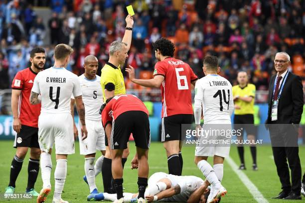 Egypt's defender Ahmed Hegazi gets a yellow card from Dutch referee Bjorn Kuipers after a foul on Uruguay's forward Luis Suarez during the Russia...