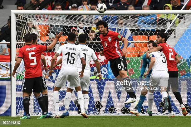 Egypt's defender Ahmed Hegazi heads the ball during the Russia 2018 World Cup Group A football match between Egypt and Uruguay at the Ekaterinburg...