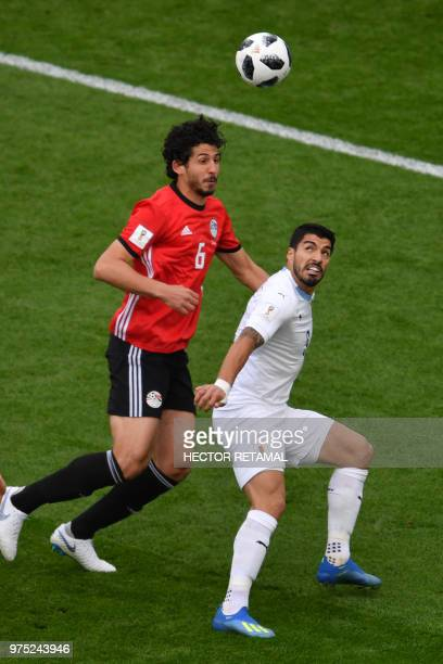 Egypt's defender Ahmed Hegazi pressures Uruguay's forward Luis Suarez during the Russia 2018 World Cup Group A football match between Egypt and...