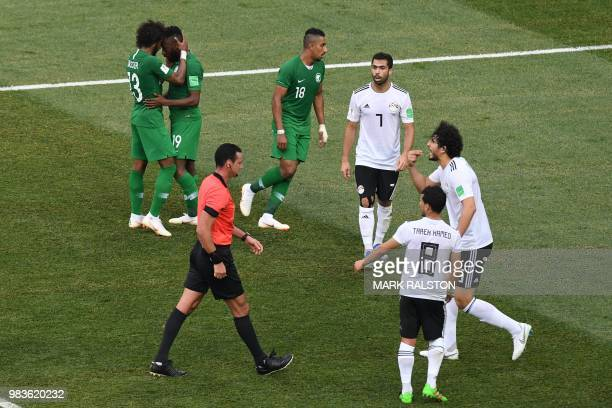 Egypt's defender Ahmed Hegazi reacts to a whistle by Colombian referee Wilmar Roldan during the Russia 2018 World Cup Group A football match between...