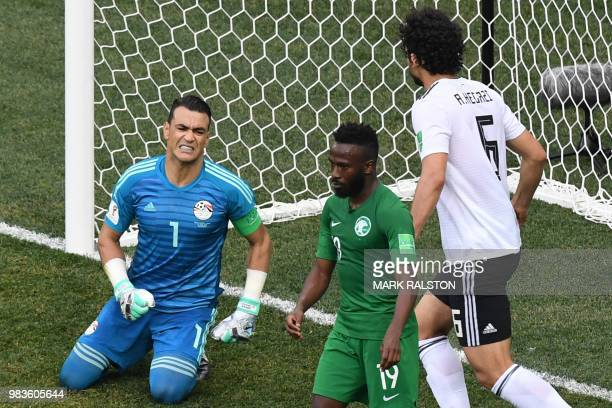 Egypt's defender Ahmed Hegazi rushes to congratulate Egypt's goalkeeper Essam El Hadary after saving a penalty during the Russia 2018 World Cup Group...
