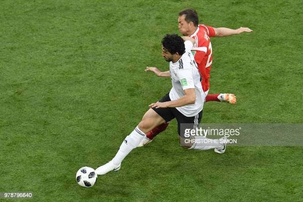 Egypt's defender Ahmed Hegazi vies for the ball with Russia's forward Artem Dzyuba during the Russia 2018 World Cup Group A football match between...