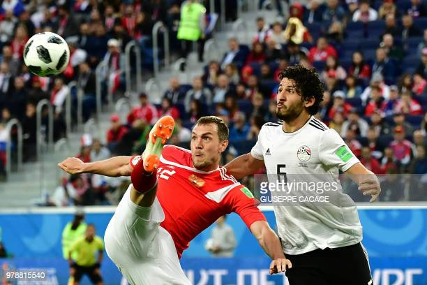 Egypt's defender Ahmed Hegazi vies with Russia's forward Artem Dzyuba during the Russia 2018 World Cup Group A football match between Russia and...