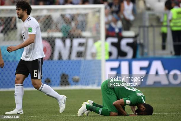 Egypt's defender Ahmed Hegazi walks past Saudi Arabia's forward Mohannad Assiri after the Russia 2018 World Cup Group A football match between Saudi...