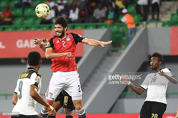 Egypt's defender Ali Gabr heads the ball between Ghana's forward Jordan Ayew and Ghana's midfielder Samuel Tetteh during the 2017 Africa Cup of...