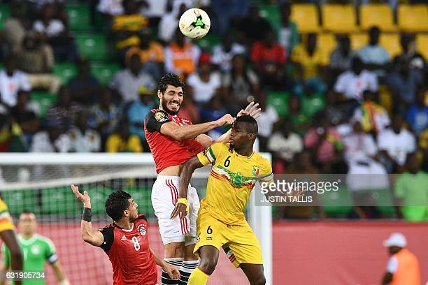 Egypt's defender Ali Gabr heads the ball next to Egypt's midfielder Tarek Hamed and Mali's midfielder Lassana Coulibaly during the 2017 Africa Cup of...