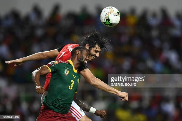 Egypt's defender Ali Gabr vies for the ball against Cameroon's defender Nicolas Nkoulou during the 2017 Africa Cup of Nations final football match...