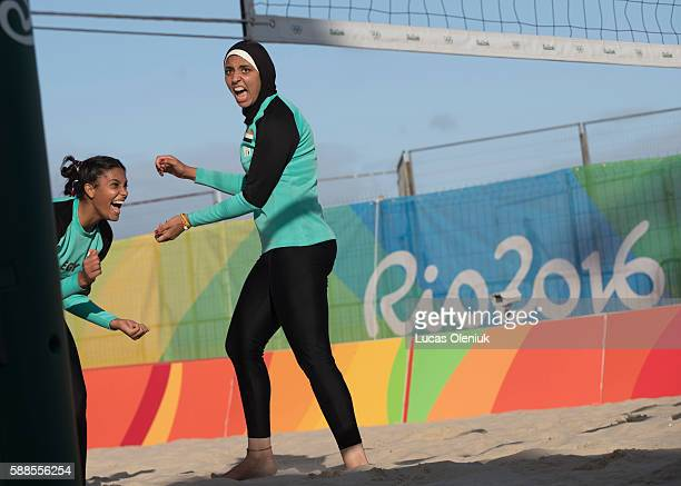 Egypt's Doaa Elghobashy and Nada Meawad celebrate a point against the Canadians Thursday afternoon at the 2016 summer Olympic Games in Rio de...