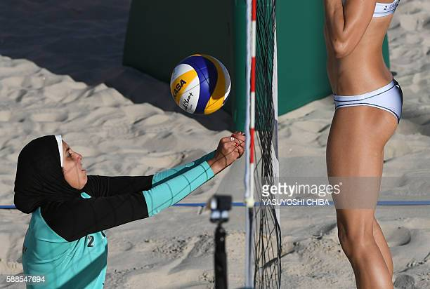 Egypt's Doaa Elghobashy controls the ball in front of Canada's Kristina Valjas during the women's beach volleyball qualifying match between Canada...