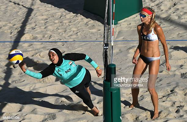 Egypt's Doaa Elghobashy dives for the ball during the women's beach volleyball qualifying match between Canada and Egypt at the Beach Volley Arena in...