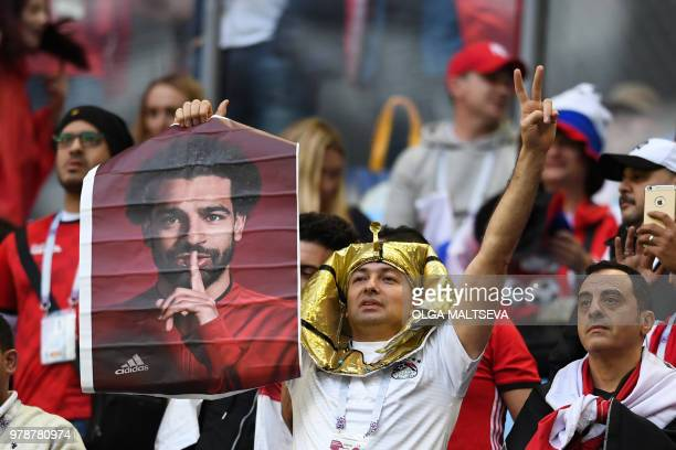 Egypt's fan holds a poster showing Egypt's forward Mohamed Salah before the Russia 2018 World Cup Group A football match between Russia and Egypt at...