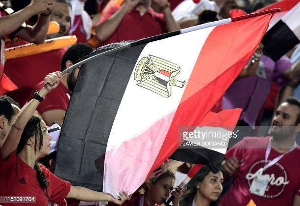 Egypt's fans wave a national flag as they cheer for their team prior to the 2019 Africa Cup of Nations football match between Egypt and DR Congo at...