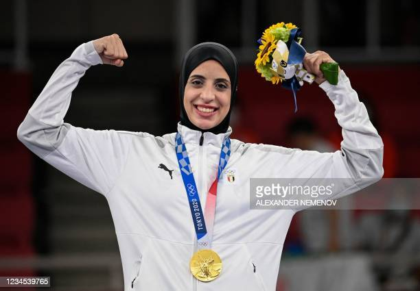 Egypt's Feryal Abdelaziz poses with her gold medal in the women's kumite +61kg in the karate competition at a ceremony during the Tokyo 2020 Olympic...