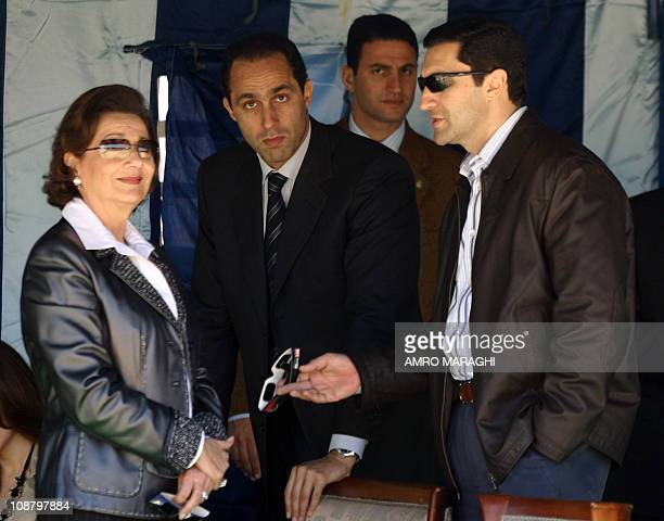 Egypt's First Lady Suzanne Mubarak and her sons Gamal and Alaa stand under a tent as they wait for the fourth total solar eclipse of the 21st century...