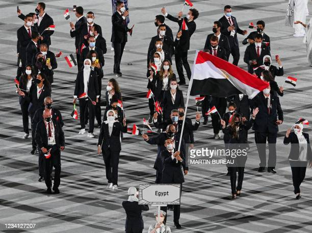 Egypt's flag bearer Alaaeldin Abouelkassem leads the delegation during the opening ceremony of the Tokyo 2020 Olympic Games, at the Olympic Stadium,...