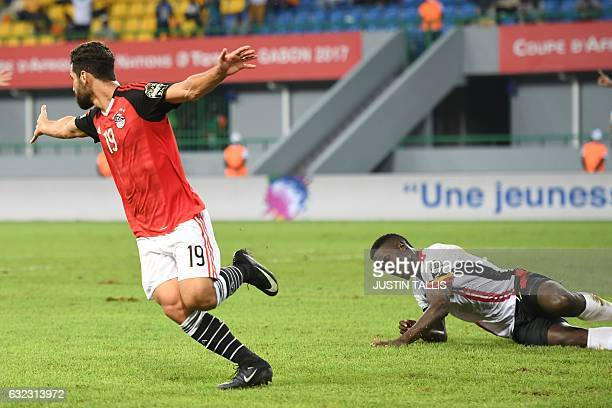 Egypt's forward Abdallah Said celebrates past Uganda's defender Murushid Juuko after scoring a goal during the 2017 Africa Cup of Nations group D...