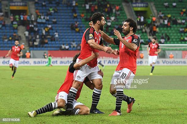 Egypt's forward Abdallah Said celebrates with teammates after scoring a goal during the 2017 Africa Cup of Nations group D football match between...