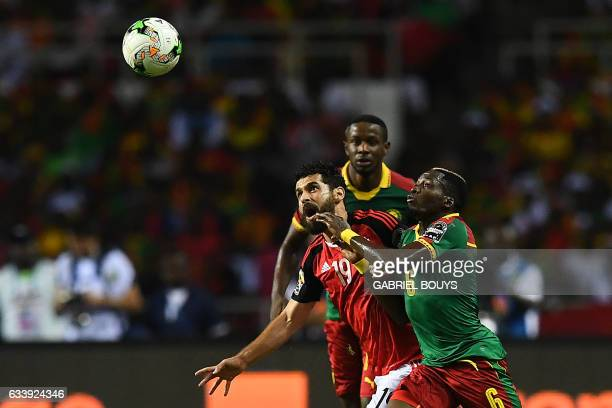 Egypt's forward Abdallah Said vies for the ball against Cameroon's defender Ambroise Oyongo during the 2017 Africa Cup of Nations final football...