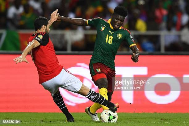 Egypt's forward Abdallah Said vies for the ball against Cameroon's midfielder Robert Ndip Tambe during the 2017 Africa Cup of Nations final football...