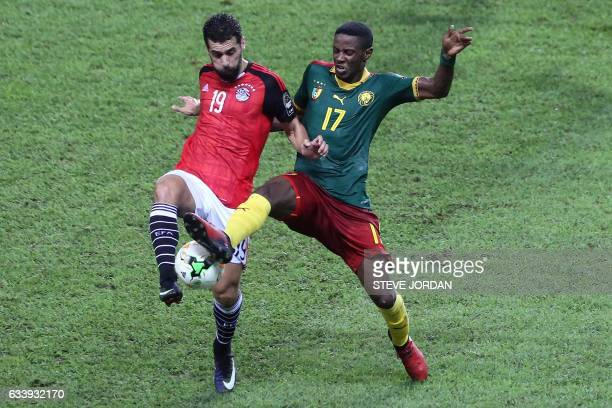 Egypt's forward Abdallah Said vies for the ball against Cameroon's midfielder Arnaud SutchuinDjoum during the 2017 Africa Cup of Nations final...