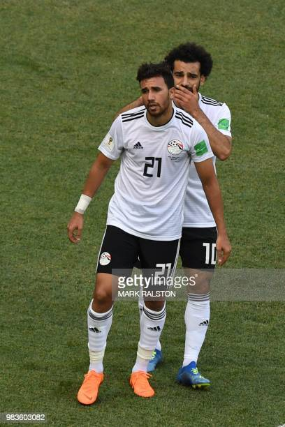 Egypt's forward Mahmoud 'Trezeguet' Hassan and Egypt's forward Mohamed Salah react to a miss during the Russia 2018 World Cup Group A football match...