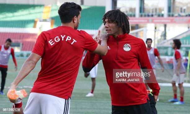Egypt's forward Mahmoud 'Trezeguet' Hassan and Egypt's midfielder Mohamed Elneny attend a training session at the Akhmat Arena stadium in Grozny on...