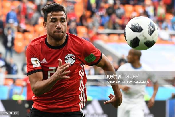 Egypt's forward Mahmoud 'Trezeguet' Hassan chases the ball during the Russia 2018 World Cup Group A football match between Egypt and Uruguay at the...