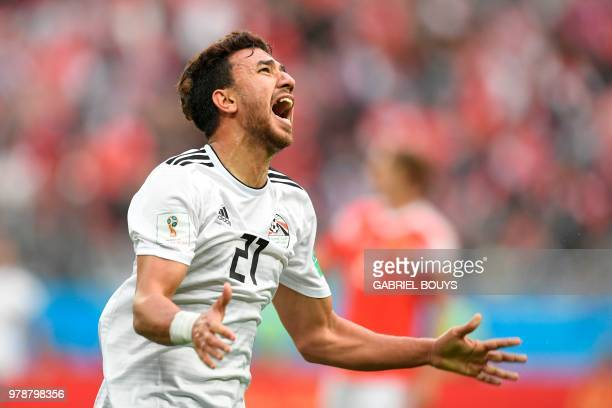 Egypt's forward Mahmoud 'Trezeguet' Hassan reacts during the Russia 2018 World Cup Group A football match between Russia and Egypt at the Saint...