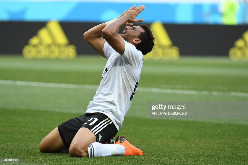 Egypt's forward Mahmoud 'Trezeguet' Hassan reacts during the Russia 2018 World Cup Group A football match between Saudi Arabia and Egypt at the Volgograd Arena in Volgograd on June 25, 2018. (Photo by Philippe DESMAZES / AFP) / RESTRICTED