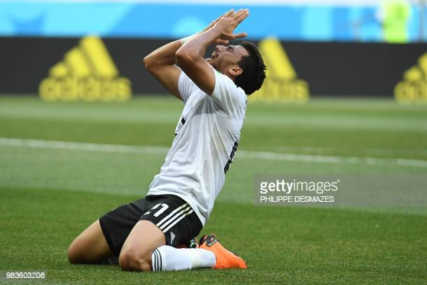 Egypt's forward Mahmoud 'Trezeguet' Hassan reacts during the Russia 2018 World Cup Group A football match between Saudi Arabia and Egypt at the...