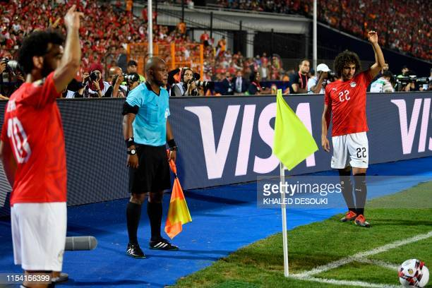 Egypt's forward Mohamed Salah and Egypt's midfielder Amr Warda stand to take a corner during the 2019 Africa Cup of Nations Round of 16 football...