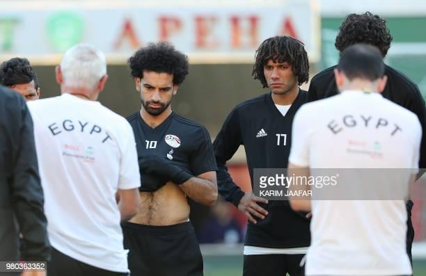 Egypt's forward Mohamed Salah and Egypt's midfielder Mohamed Elneny listen to Egypt's coach Hector Raul Cuper during a training session at the Akhmat...