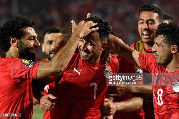 Egypt's forward Mohamed Salah and Egypt's midfielder Tarek Hamed congratulate Egypt's midfielder Mahmoud 'Trezeguet' Hassan on his goal during the...