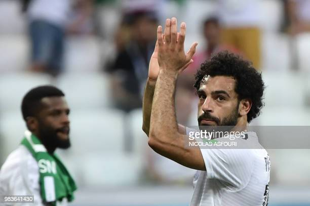 TOPSHOT Egypt's forward Mohamed Salah applauds after the Russia 2018 World Cup Group A football match between Saudi Arabia and Egypt at the Volgograd...