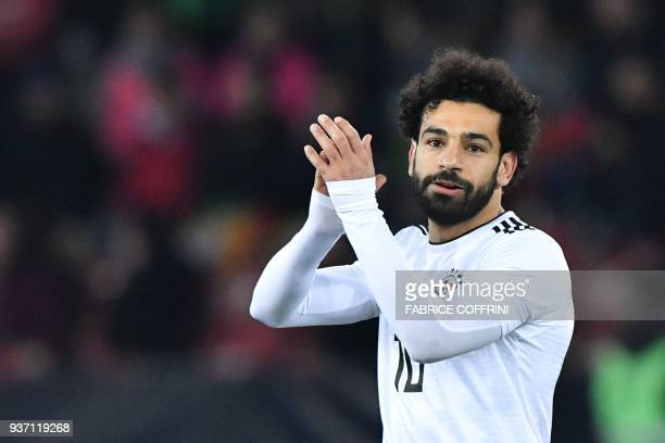 Egypt's forward Mohamed Salah applauds during an international friendly football match between Portugal and Egypt at Letzigrund stadium in Zurich on...