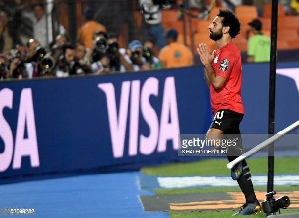 TOPSHOT Egypt's forward Mohamed Salah celebrates after scoring a goal during the 2019 Africa Cup of Nations football match between Egypt and DR Congo...