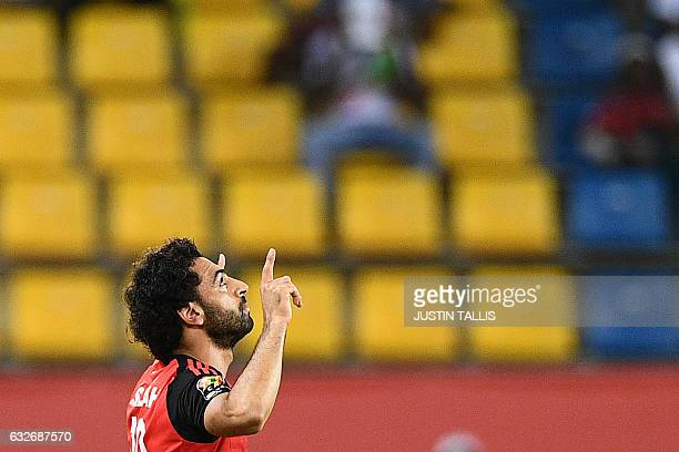 TOPSHOT Egypt's forward Mohamed Salah celebrates after scoring a goal during the 2017 Africa Cup of Nations group D football match between Egypt and...