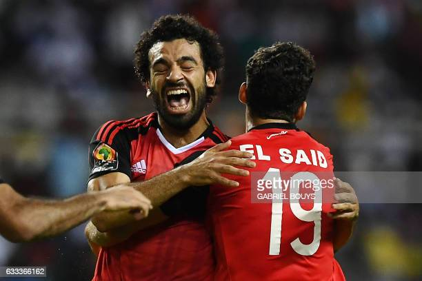 Egypt's forward Mohamed Salah celebrates with Egypt's forward Abdallah Said after scoring a goal during the 2017 Africa Cup of Nations semifinal...