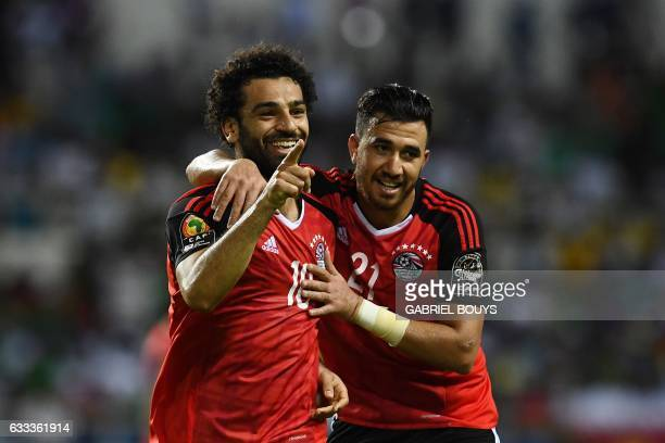 Egypt's forward Mohamed Salah celebrates with Egypt's midfielder Mahmoud Hassan after scoring a goal during the 2017 Africa Cup of Nations semifinal...