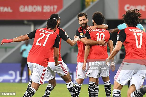 Egypt's forward Mohamed Salah celebrates with teammates after scoring a goal during the 2017 Africa Cup of Nations group D football match between...