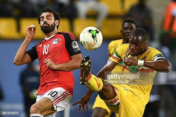 Egypt's forward Mohamed Salah challenges Mali's midfielder Yacouba Sylla during the 2017 Africa Cup of Nations group D football match between Mali...