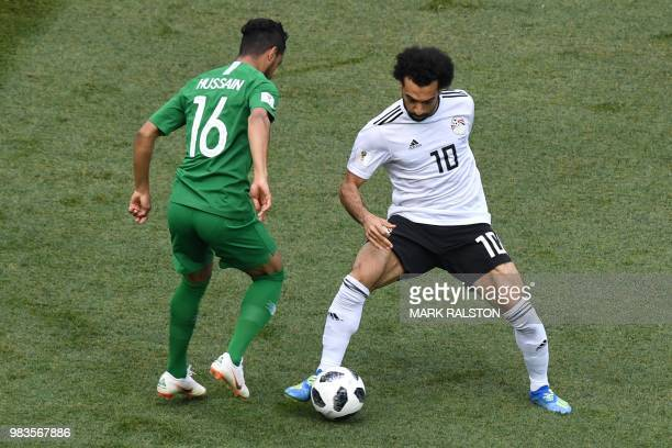 Egypt's forward Mohamed Salah dribble spast Saudi Arabia's midfielder Hussain Al Moqahwi during the Russia 2018 World Cup Group A football match...