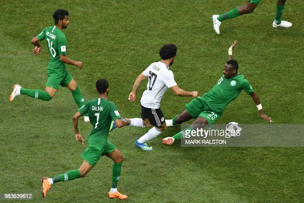 Egypt's forward Mohamed Salah dribbles past Saudi players during the Russia 2018 World Cup Group A football match between Saudi Arabia and Egypt at...