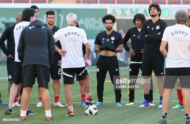 Egypt's forward Mohamed Salah Egypt's midfielder Mohamed Elneny and Egypt's defender Ahmed Hegazi listen to Egypt's coach Hector Raul Cuper with...